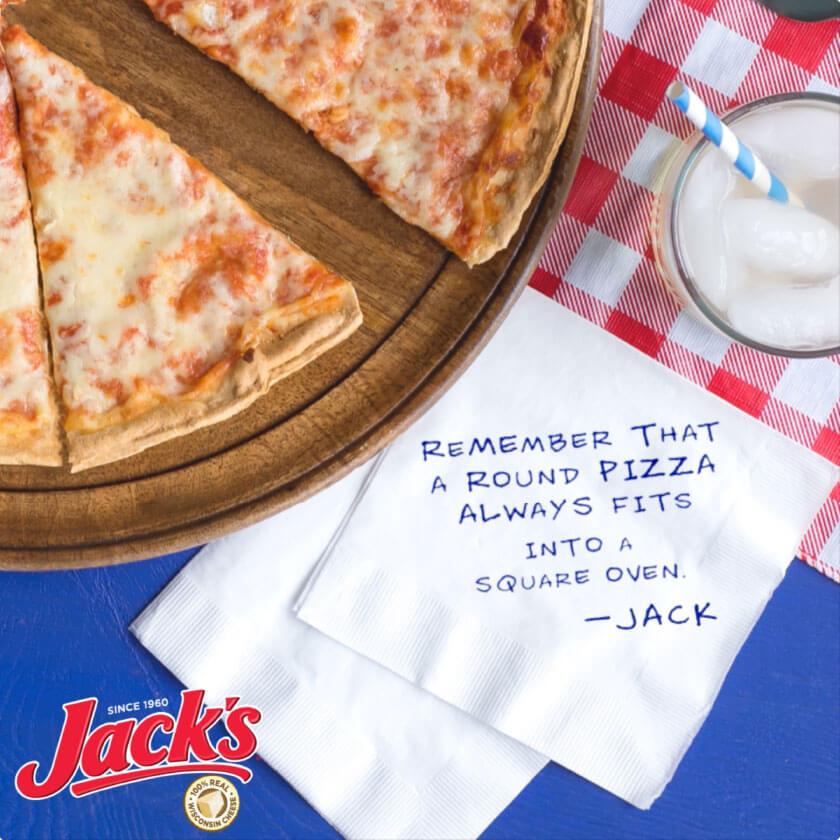 An overhead shot of pizza, with writing on the napkin that reads: Remeber that a round pizza always fits into a square oven. -Jack